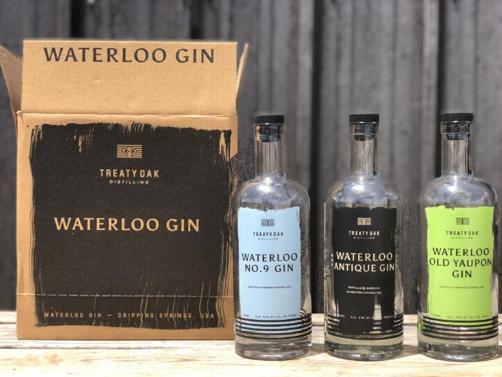 Bottles of Waterloo Gin with shipping box from Treaty Oak Distilling near austin texas