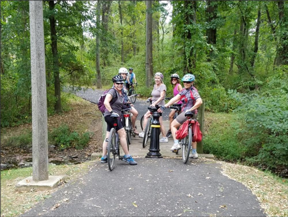 A group of bikers gathered on the Lawrence Hopewell Trail near Princeton