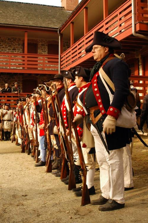 Reenactors standing at attention at the Old Barracks Museum