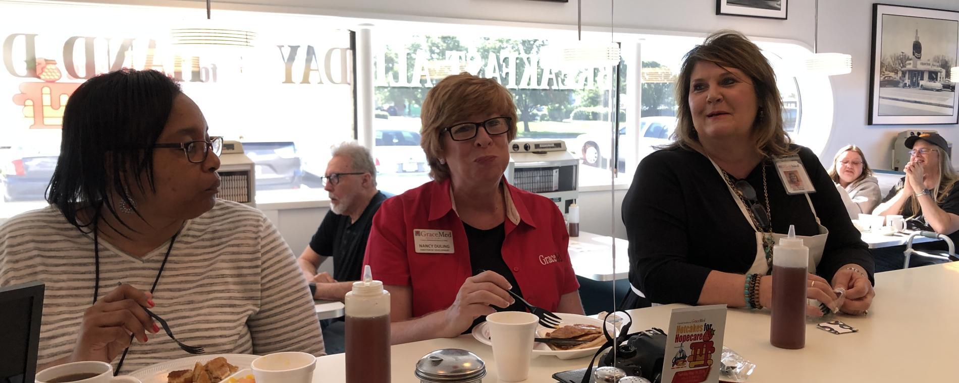 North-ladies at counter Visit Wichita