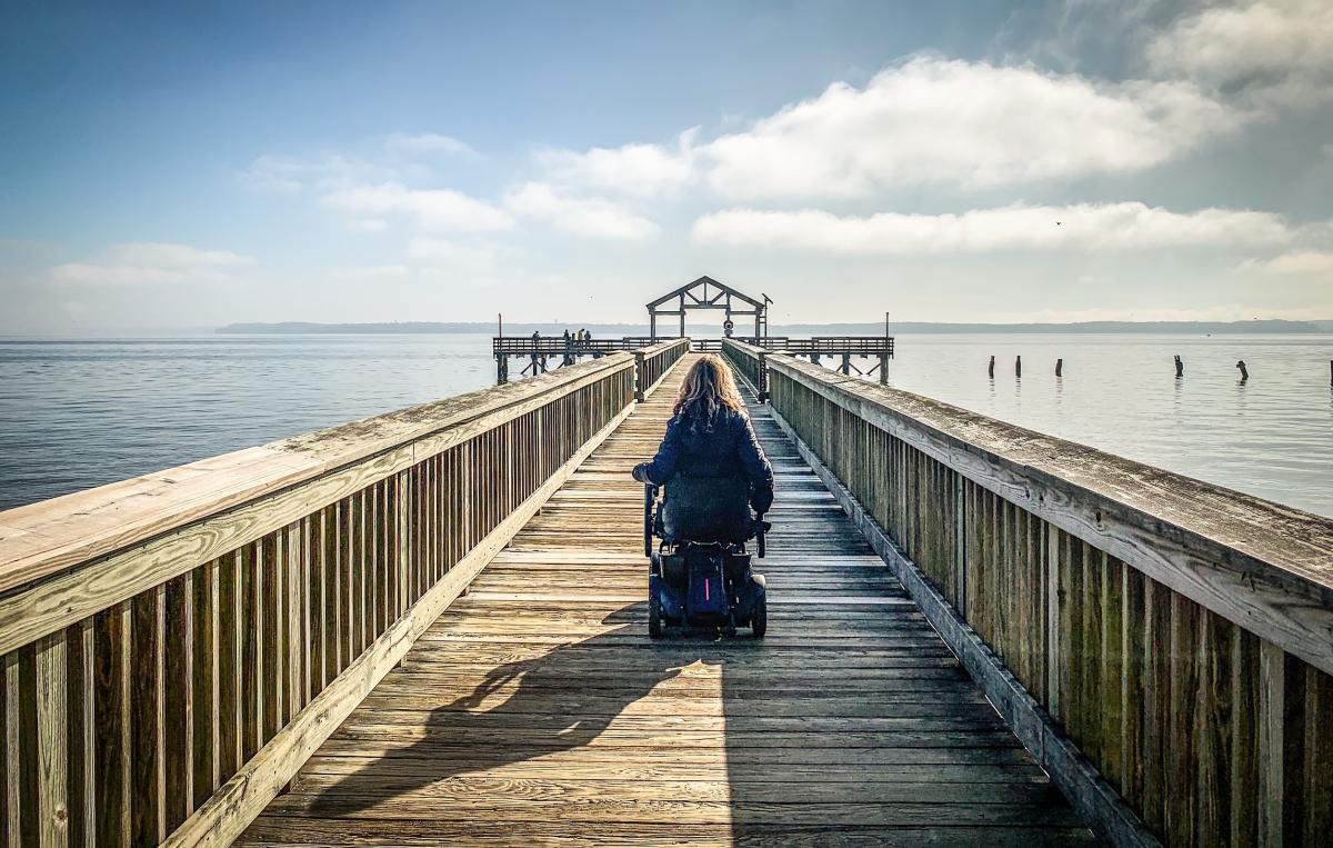 woman in wheelchair on fishing pier at Leesylvania State Park