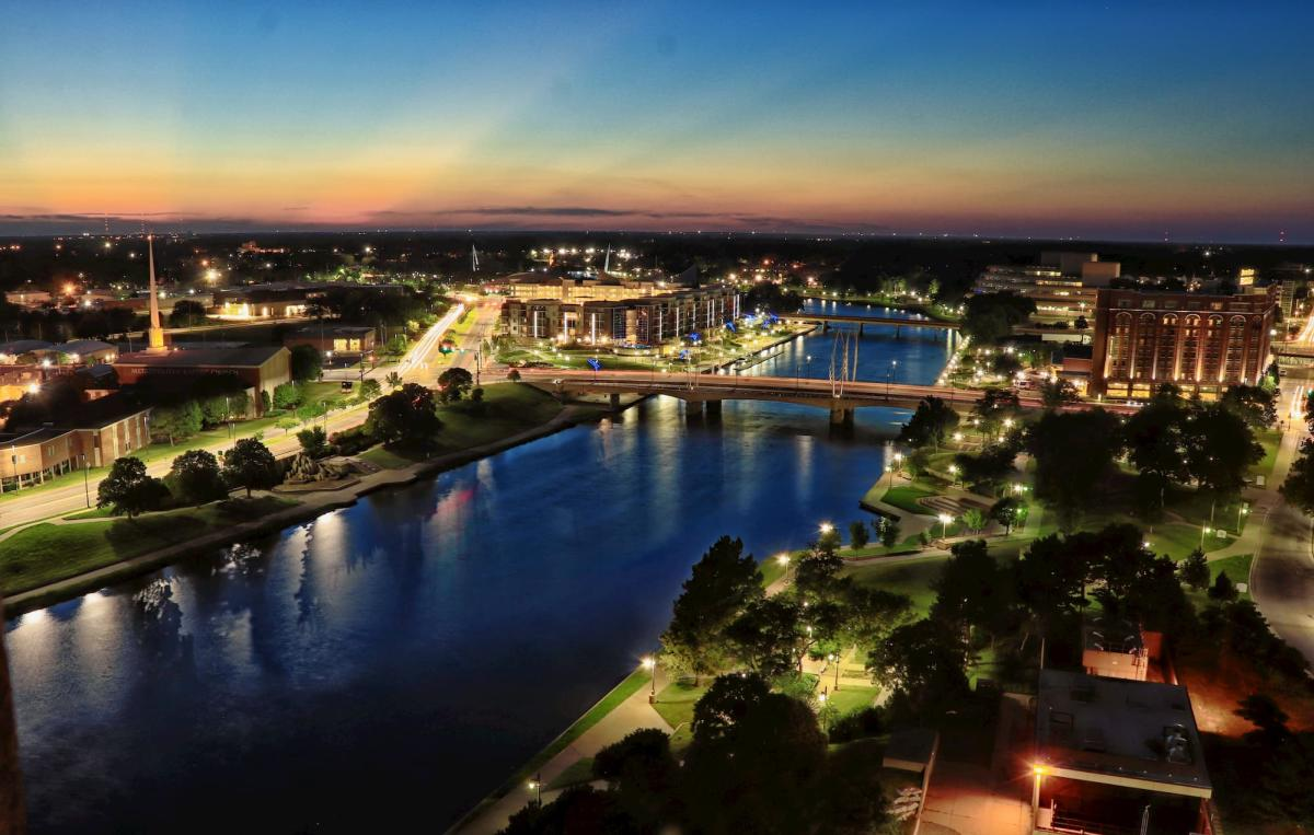 Downtown shot of Wichita KS showing river and east and west bank development