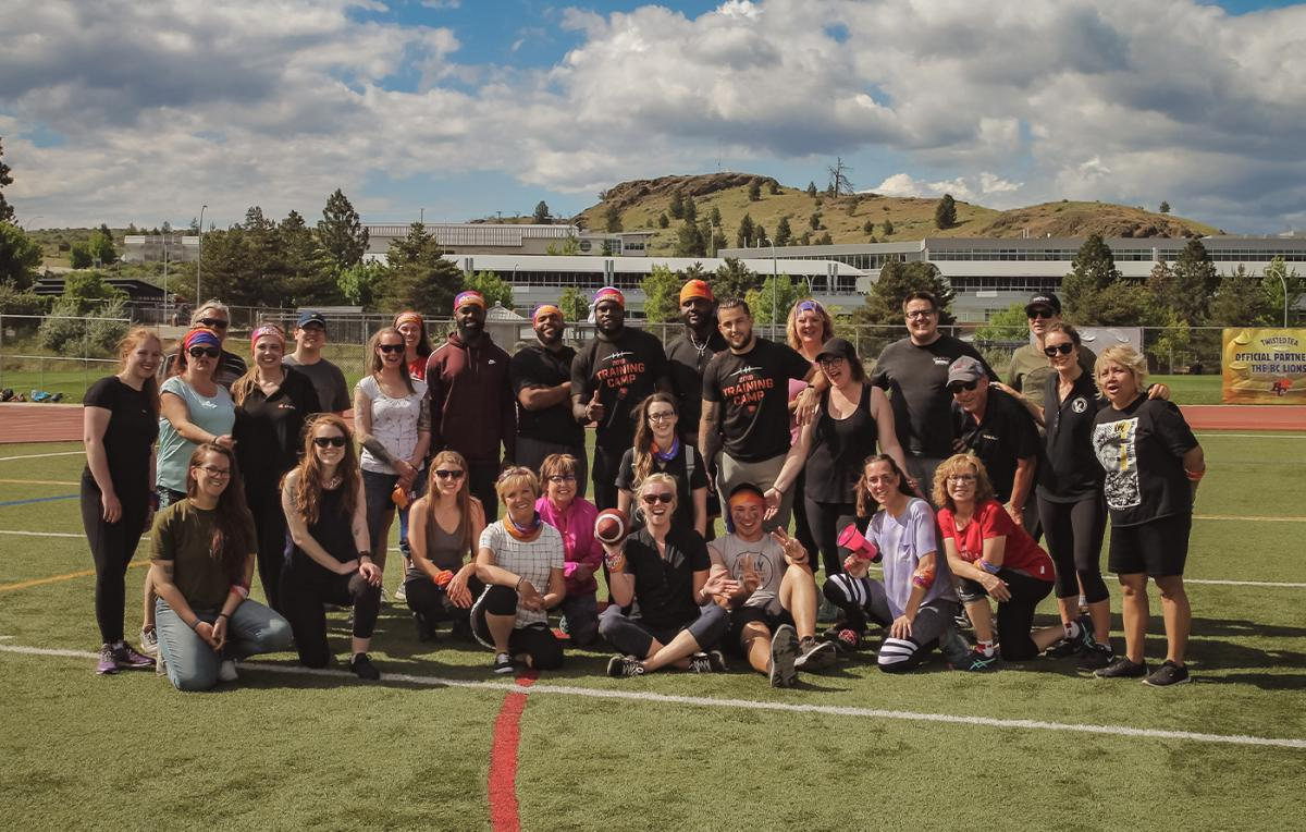 Luv'n the loops number 3 group photo with the BC Lions