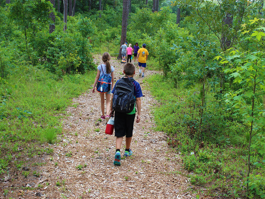 Howell Woods Summer Camp hiking trails and other fun activities.