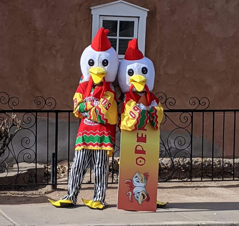 Los Pollos Telling Folks We ARE Open
