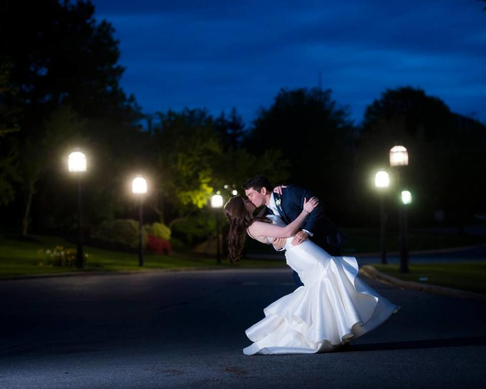 Wedding Couple Kissing in the Lit Driveway
