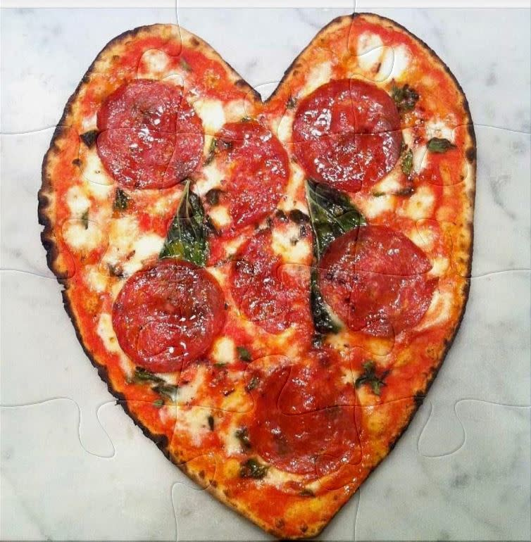 Nomad Pizza shaped in a heart