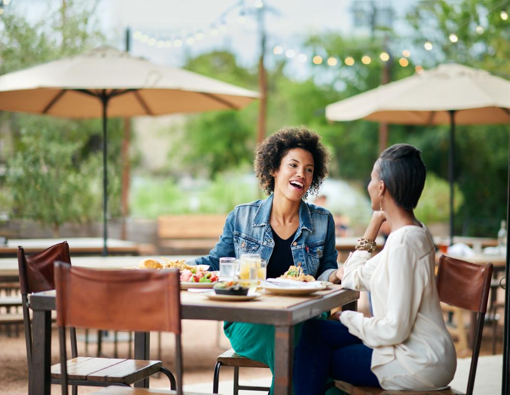 Women dining on the patio at Contigo in Austin Texas