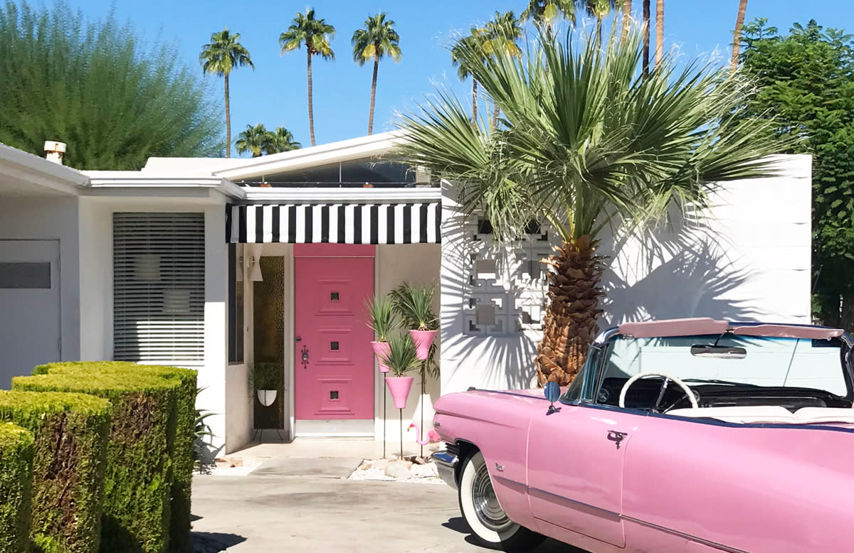 Pink door and pink Cadillac on the Palm Springs Door Tour