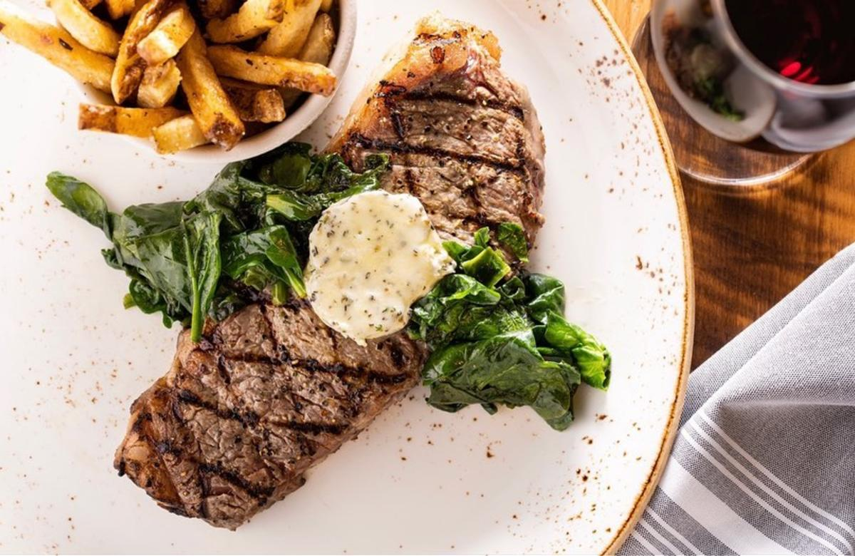 A plated steak and fries dish from The Public House at Sea Palms Resort on St. Simons Island, GA