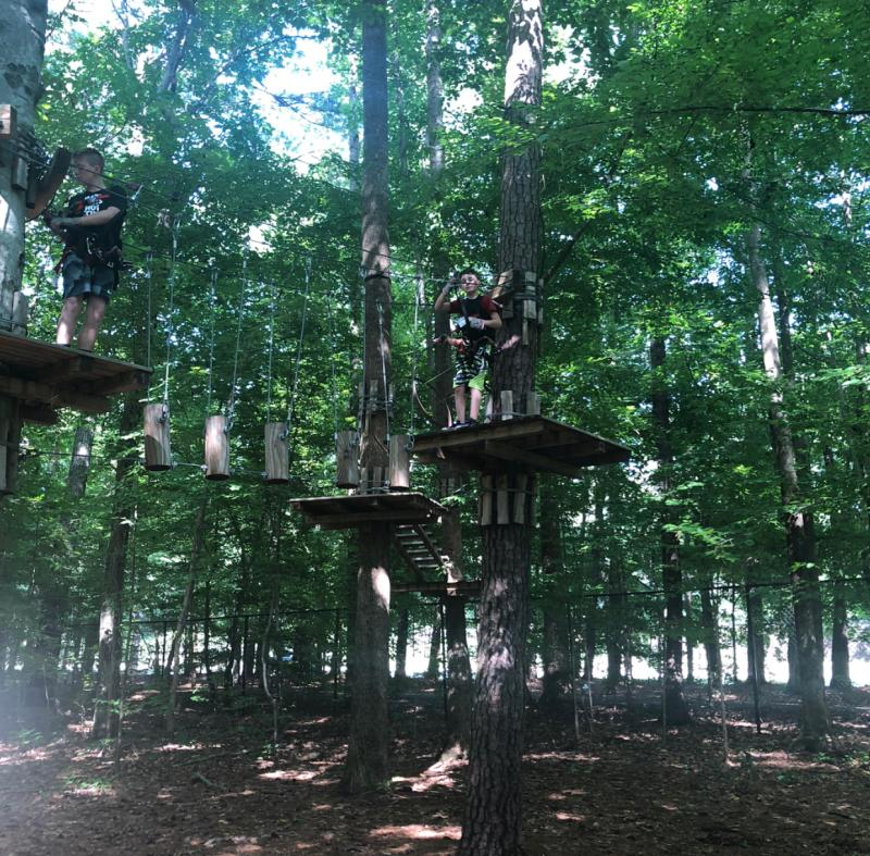 Kids going through the treetop obstacle course at Adventure Park