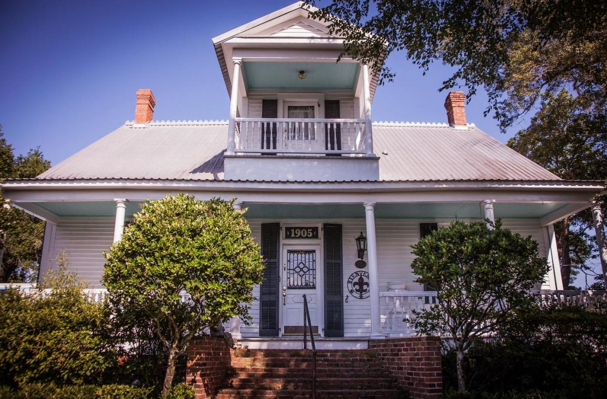 The front view of an 1890 Victorian home in Lafayette, T'Frere's House.