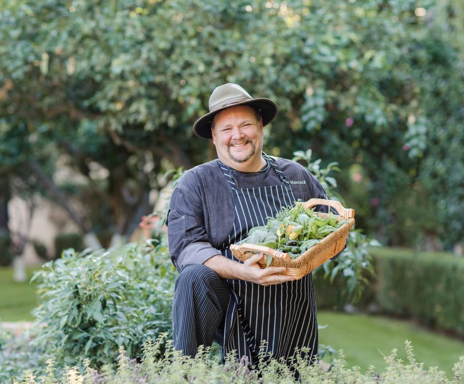 Chef in herb garden