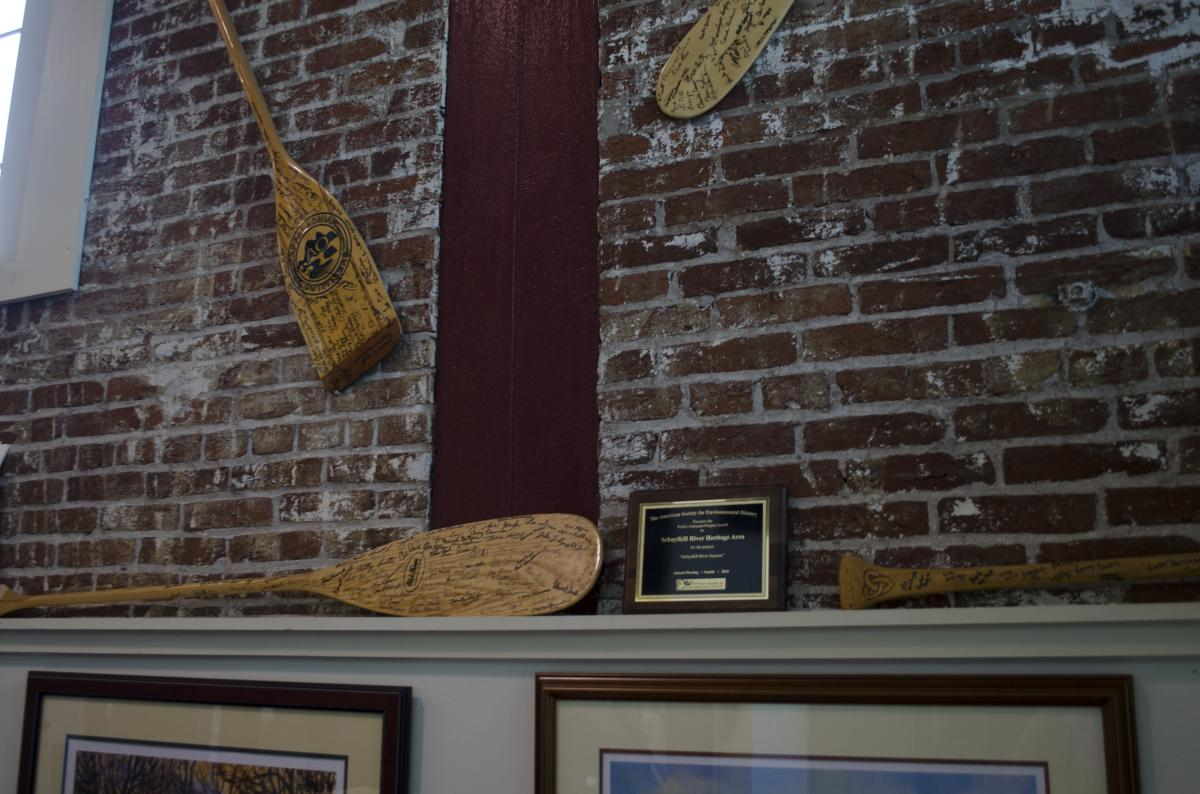 Autographed paddles from every Schulykill River Sojourn adorn the walls of the Heritage Area office.
