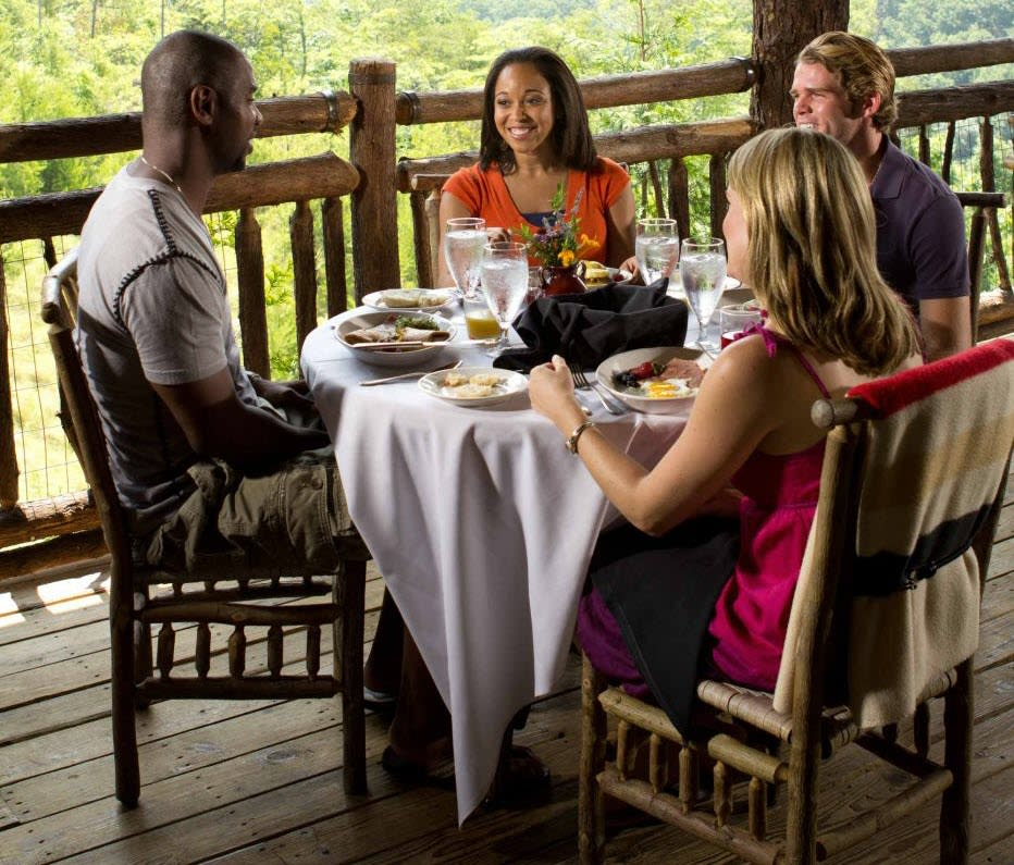 People Dining at Table on Porch