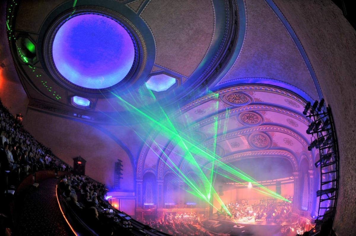 Green lights shining on the ceiling during a performance at the Temple Theatre in Saginaw, MI