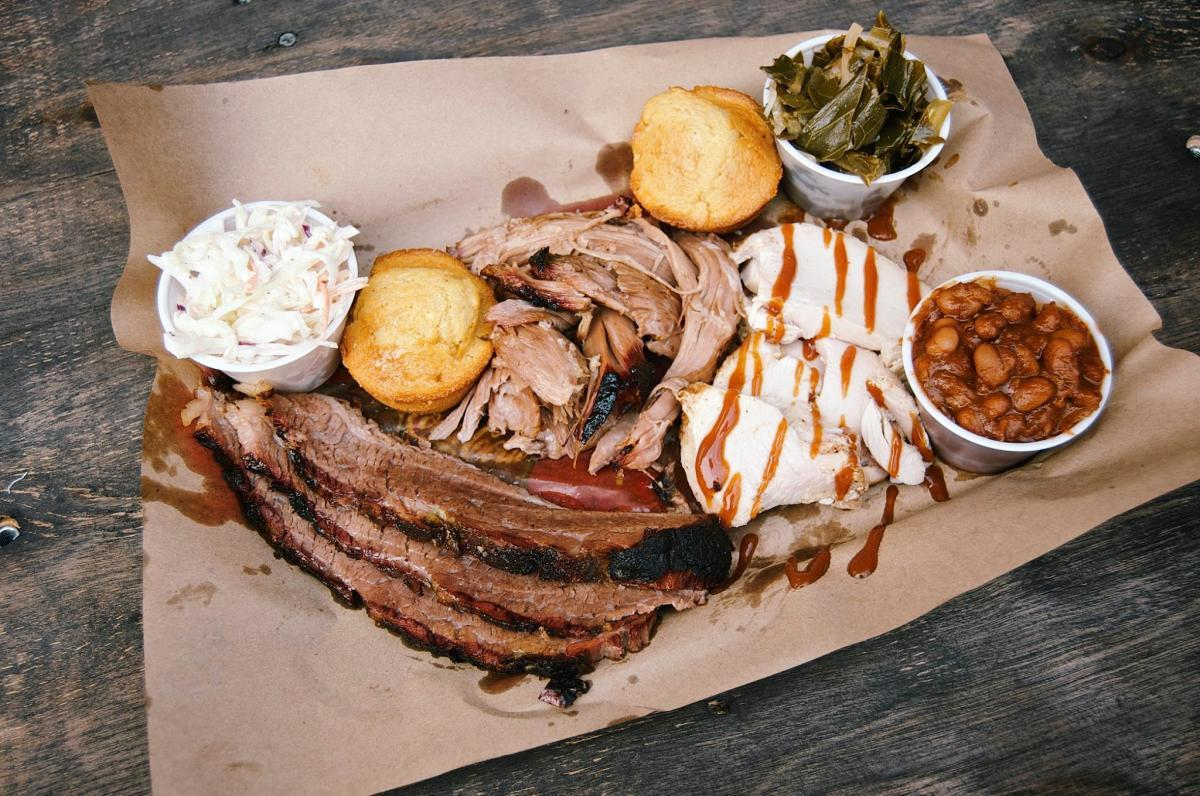 The Bone BBQ platter with meats, beans, coleslaw, corn bread and collard greens