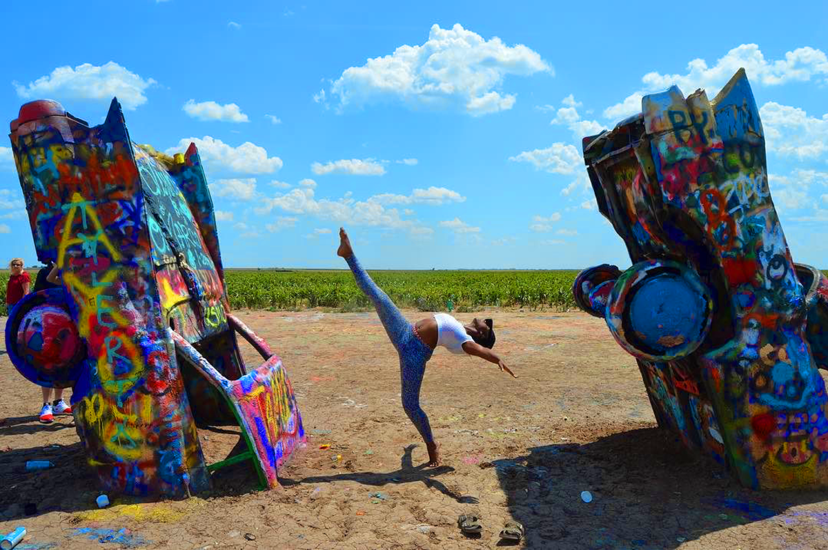 Girl dancing at Cadillac ranch