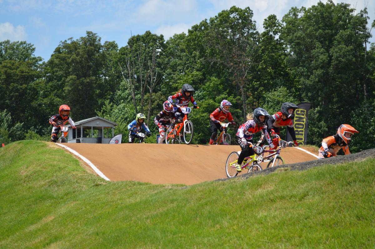 young BMX bikers participating in a race on a course