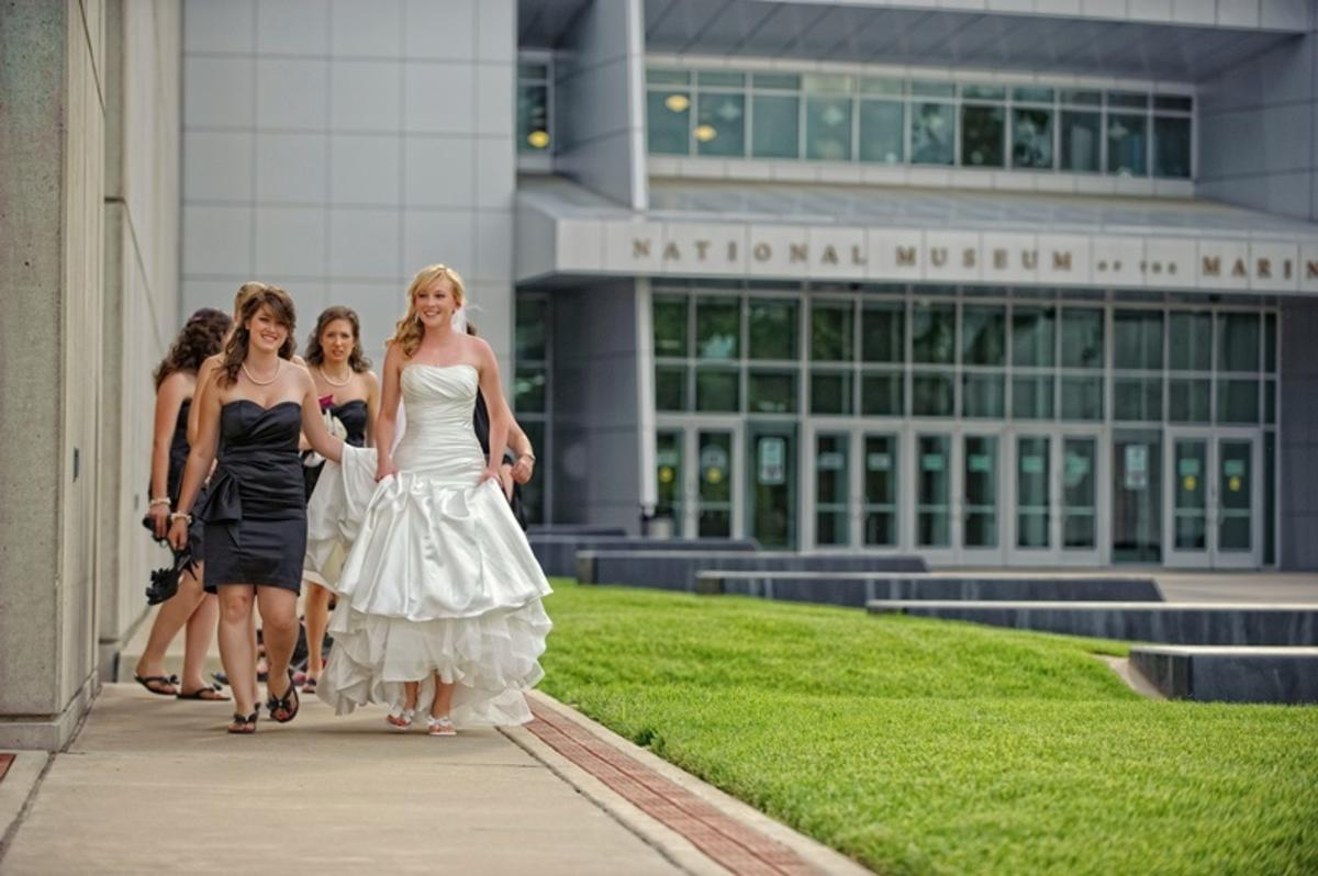 bride and bridesmaids walking outside at national museum of the marine corps