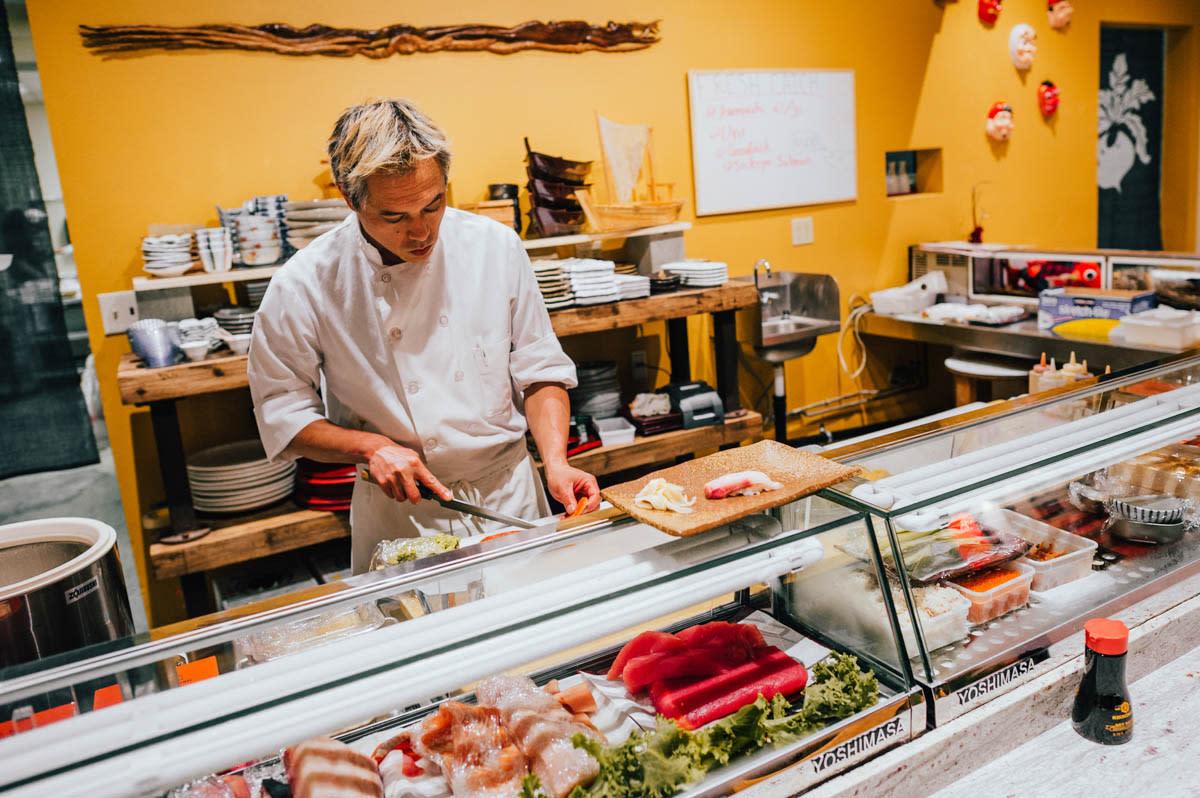 Miyabi Sushi Chef Preparing Sushi Behind Counter