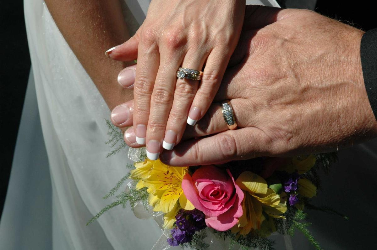 Married Couple with Rings and Flowers