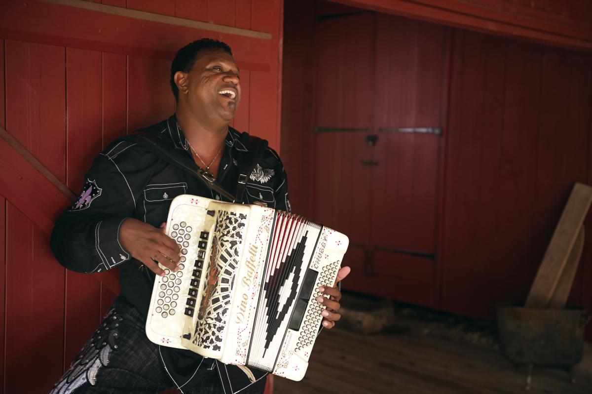 Chubby Carrier playing accordion