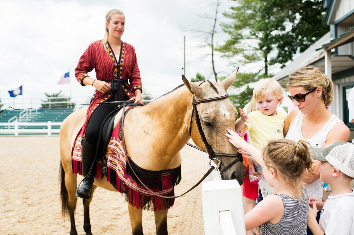 Kids petting horse at the Kentucky Horse Park.