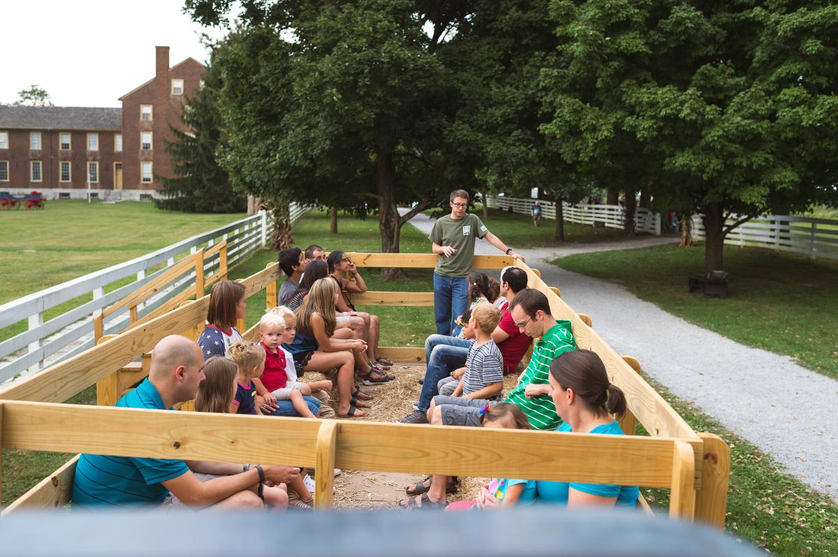 People enjoying a wagon ride at Shaker Village of Pleasant Hill