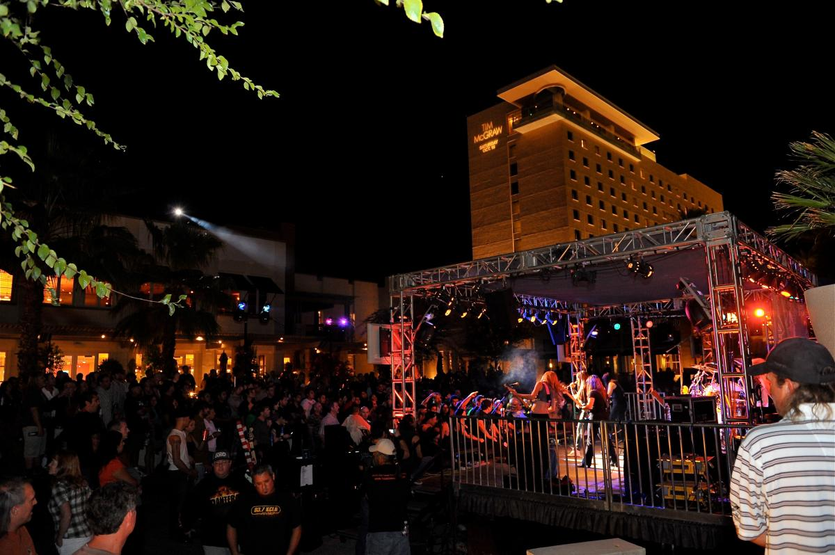 A crowd watches a cover band at The Rock Yard at Fantasy Springs Resort Casino