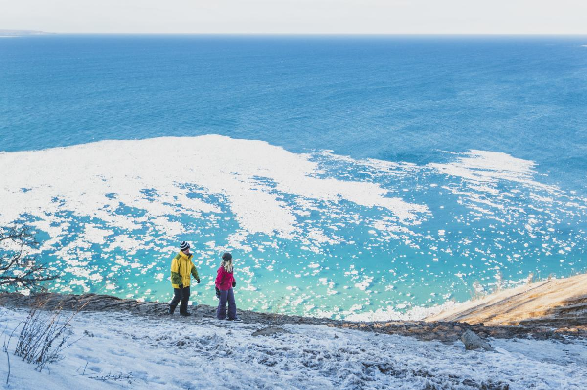Couple Hiking Sleeping Bear Dunes in Winter