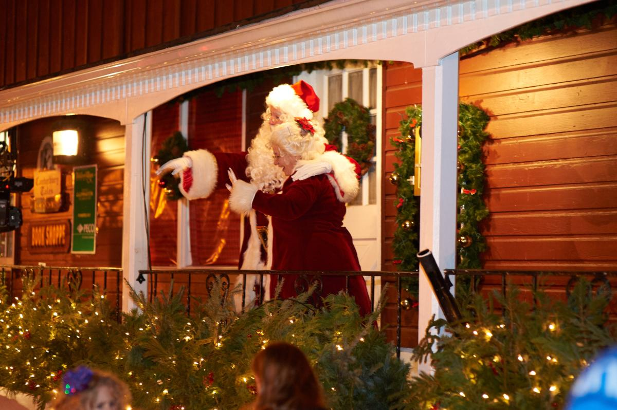 Santa and Mrs. Claus greet the crowd during Grand Illumination at Peddler's Village.