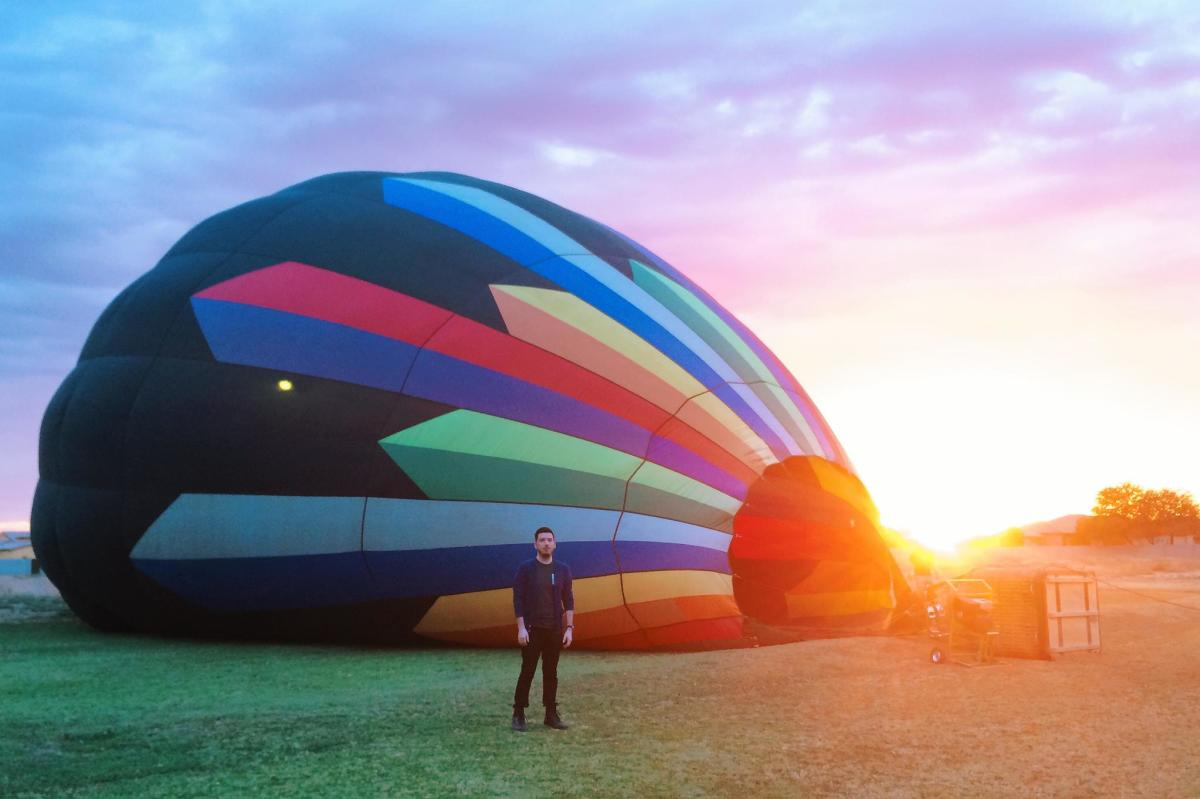 Man in Front of a Hot Air Balloon at Aerogelic Ballooning in Chandler