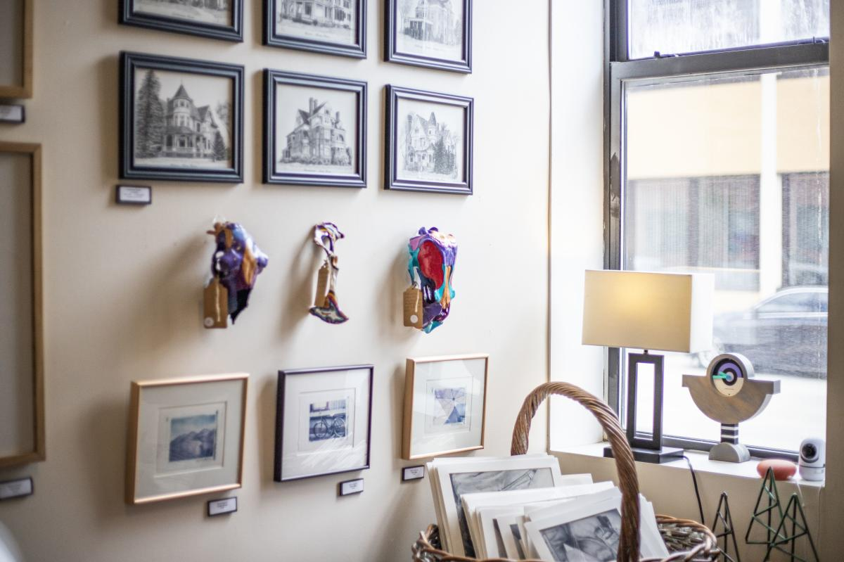 Artwork hangs on display at the art gallery at 200 Main in Eau Claire.