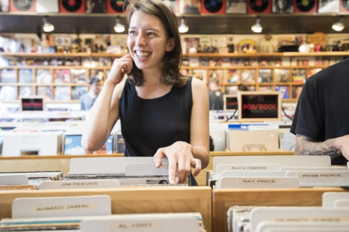Looking through records at Revival Records in downtown Eau Claire