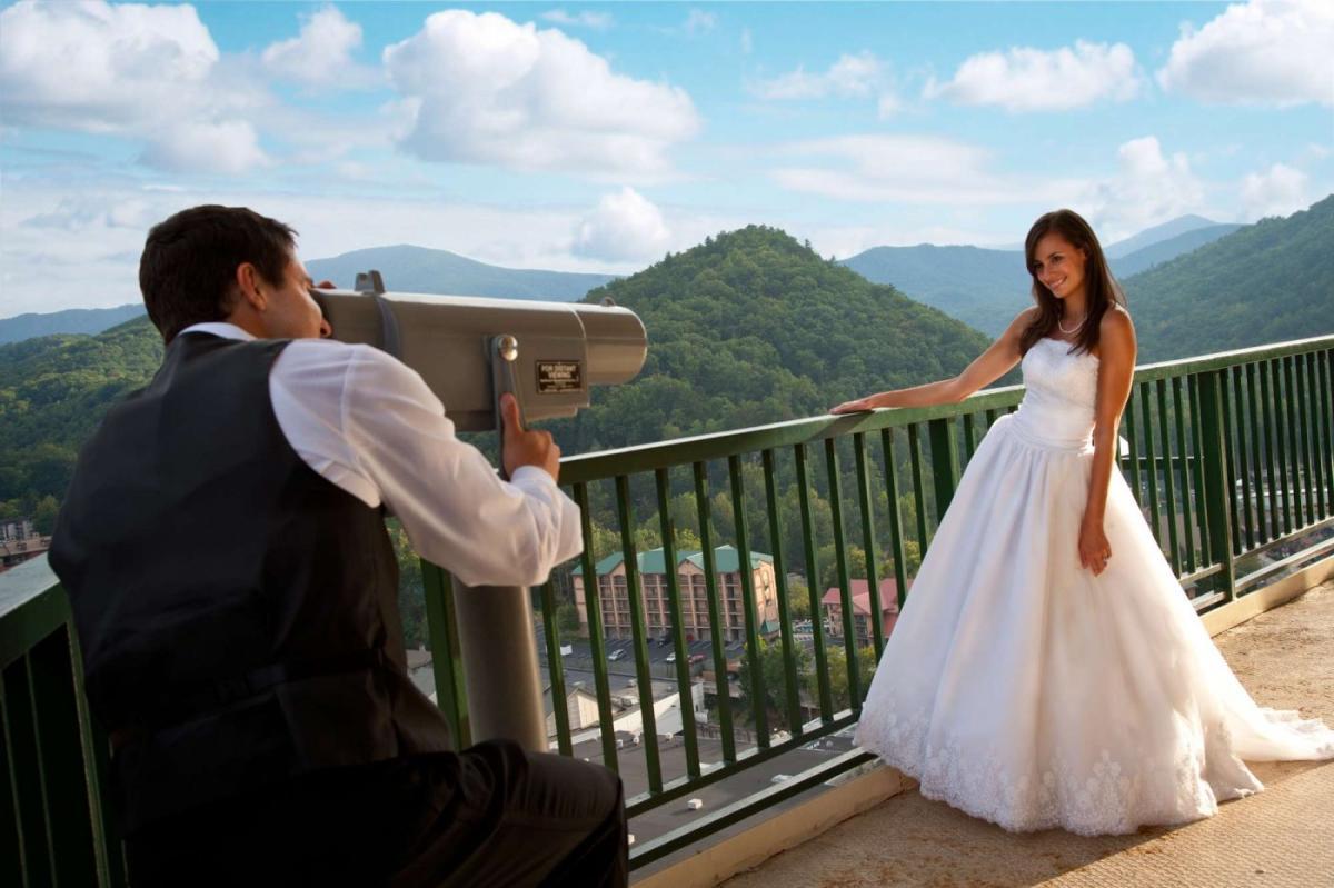 Man Looking at Bride Through Telescope
