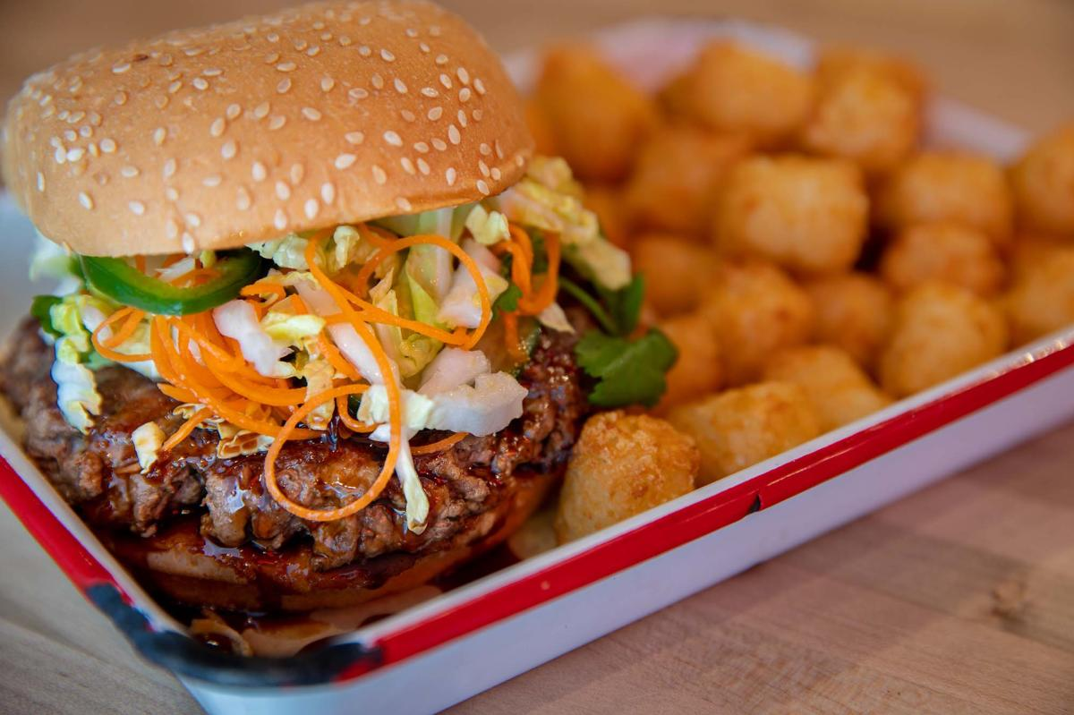 A plated burger dish from Certified Burgers & Beverage on St. Simons Island, GA