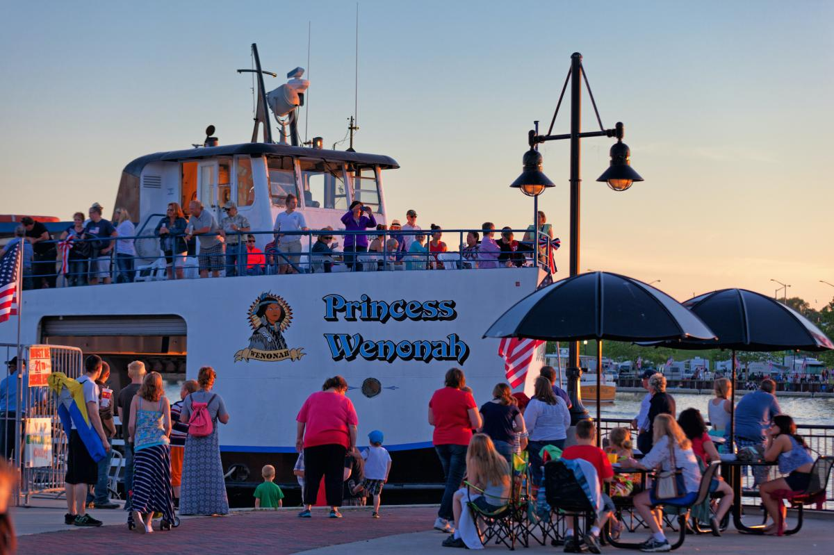 Visitors gather along the shores of the Saginaw River to see the Bay City Boat Lines' Princess Wenonah