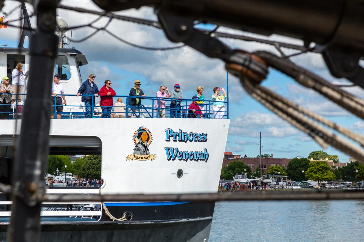 The Princess Wenonah cruises down the Saginaw River as passengers and visitors take in the sites