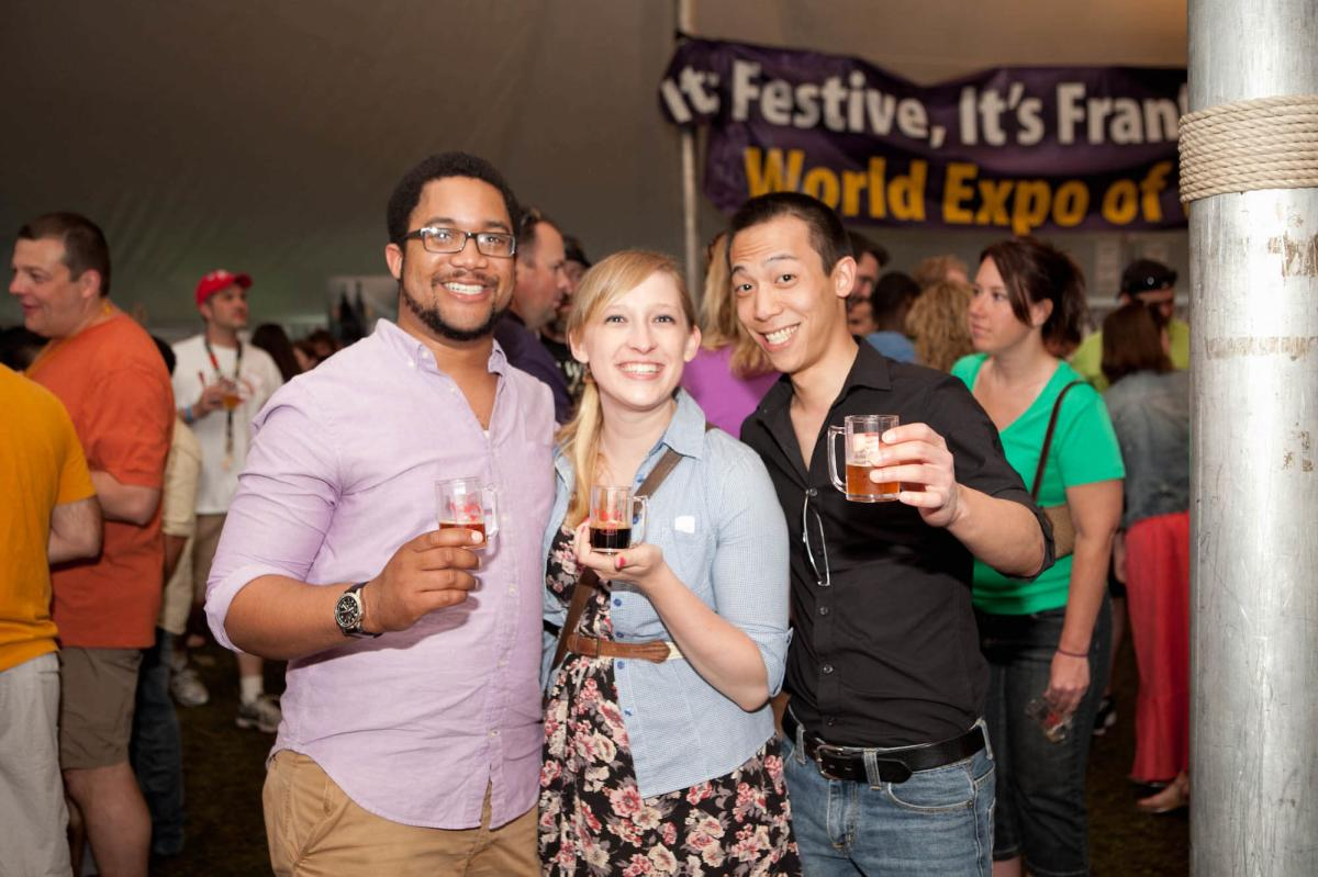 Friends pose for a picture while sampling at the World Expo of Beer in Frankenmuth, MI