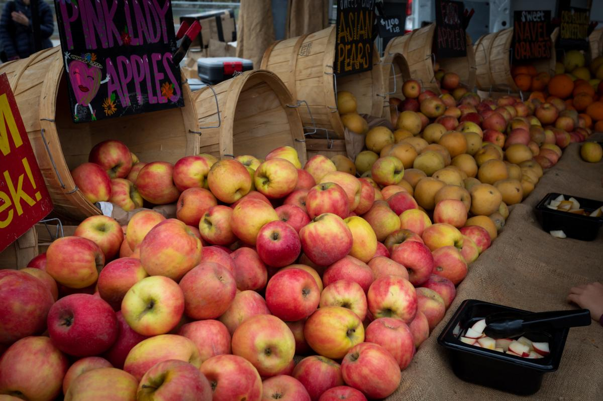 Apples-fuji-pink-lady-on-a-table-from-barrels-at-Farmers-Market