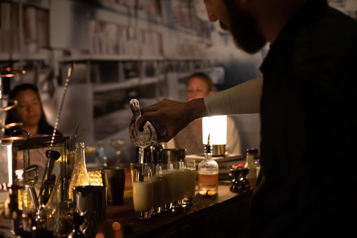 A bartender pours drinks at The Butchershop in the Irvine Marriott