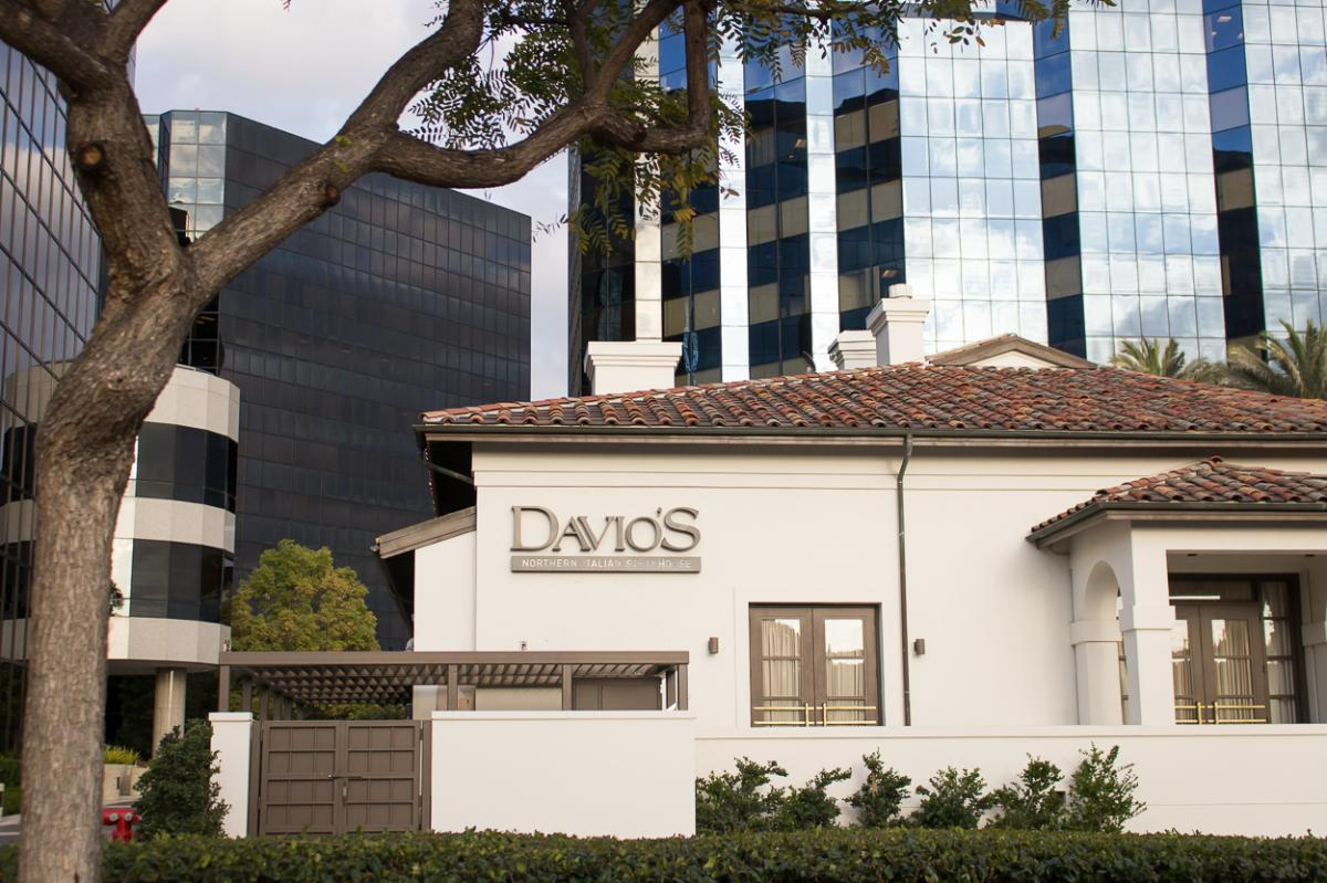 Exterior of Davio's Northern Italian Steakhouse in Irvine with office building and tree