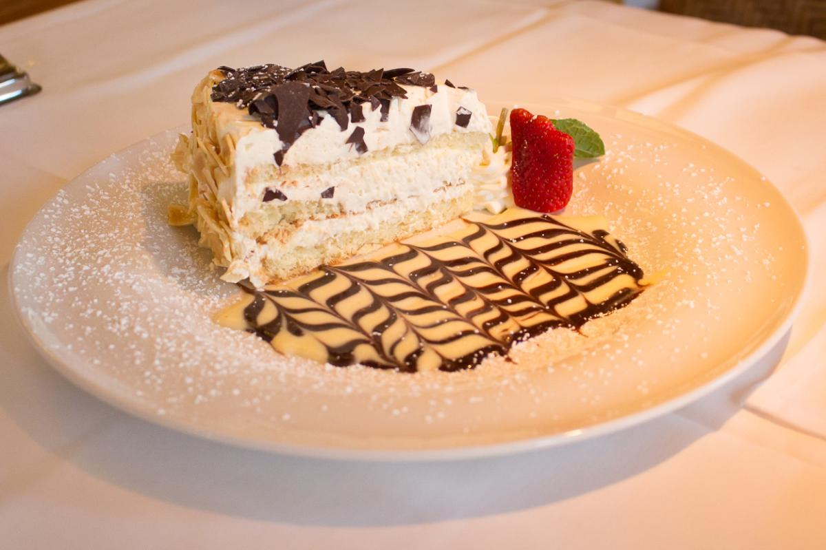 Plate of Torta Allo Zabaione sponge cake with chocolate shavings