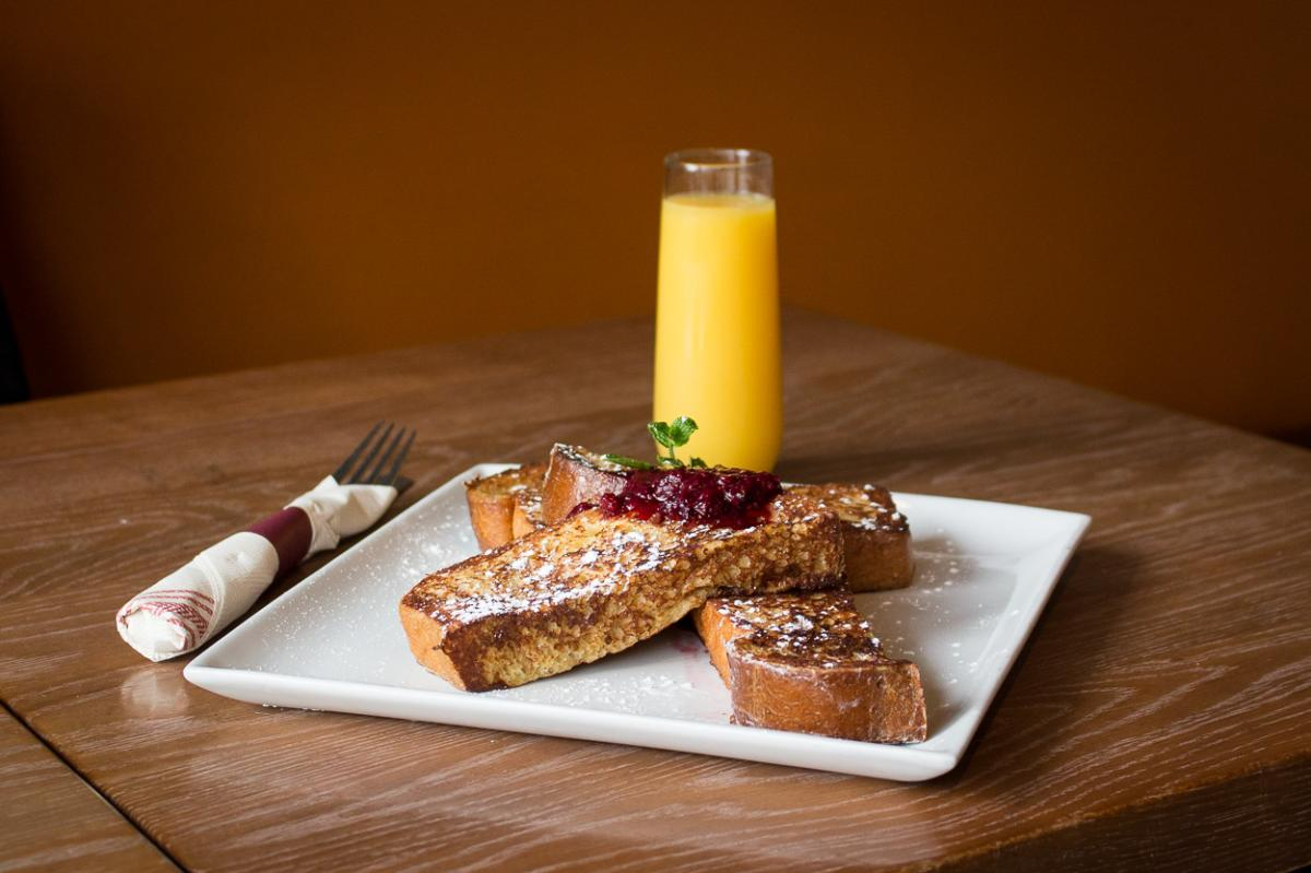 Square plate with French toast bites and orange juice