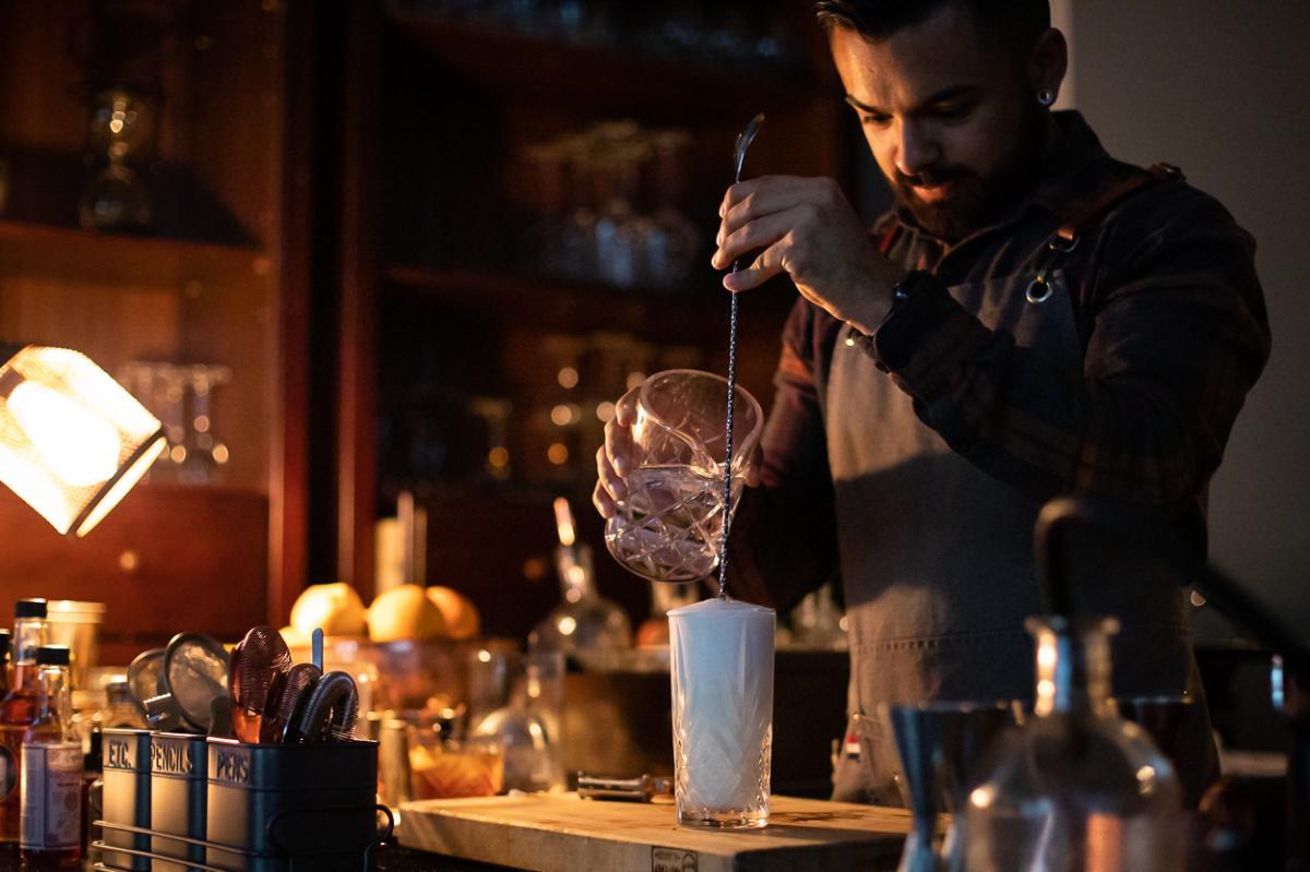 Bartender pouring a drink at Y.N.K. in Irvine