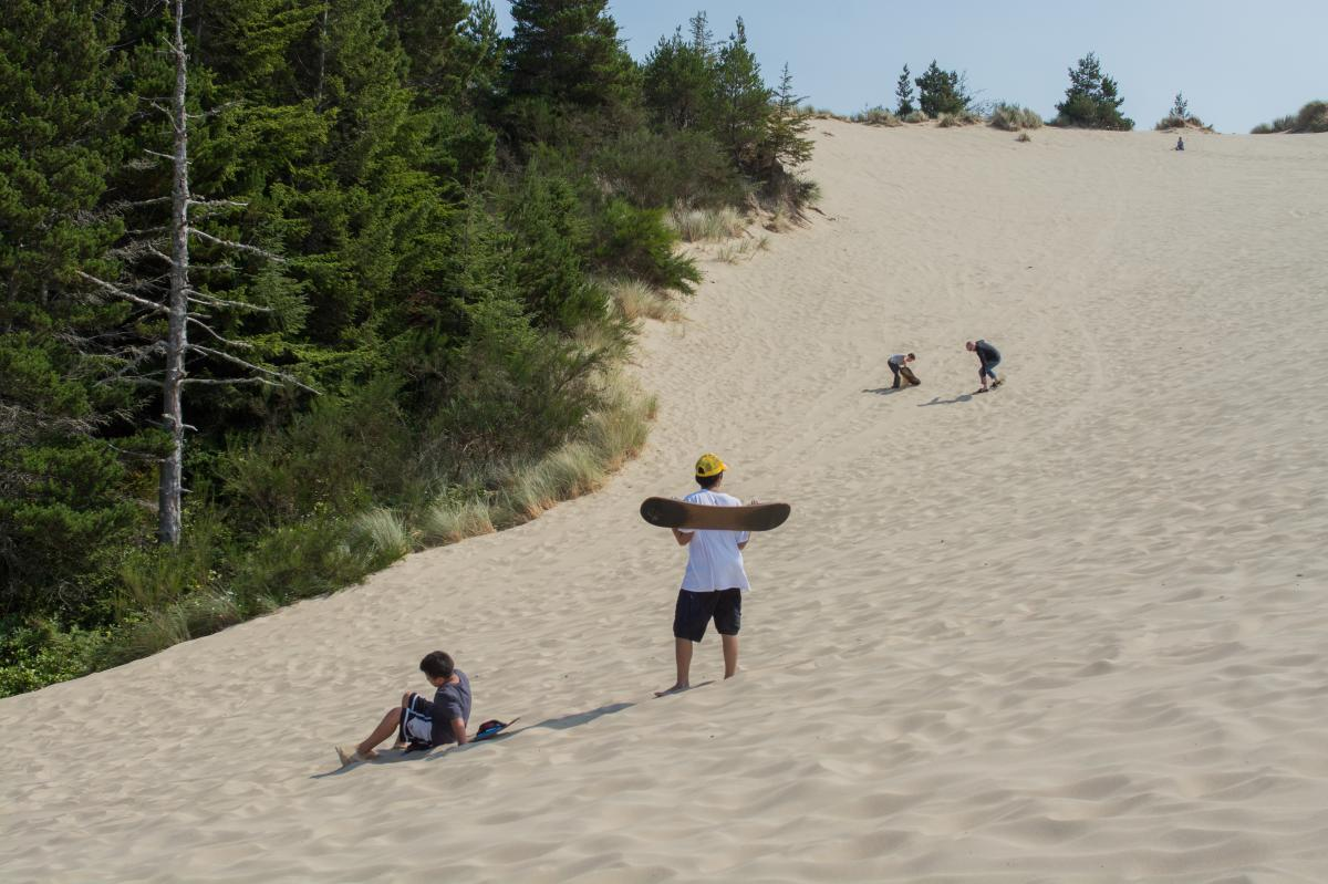 Sandboarding at the Oregon Dunes by Thomas Moser
