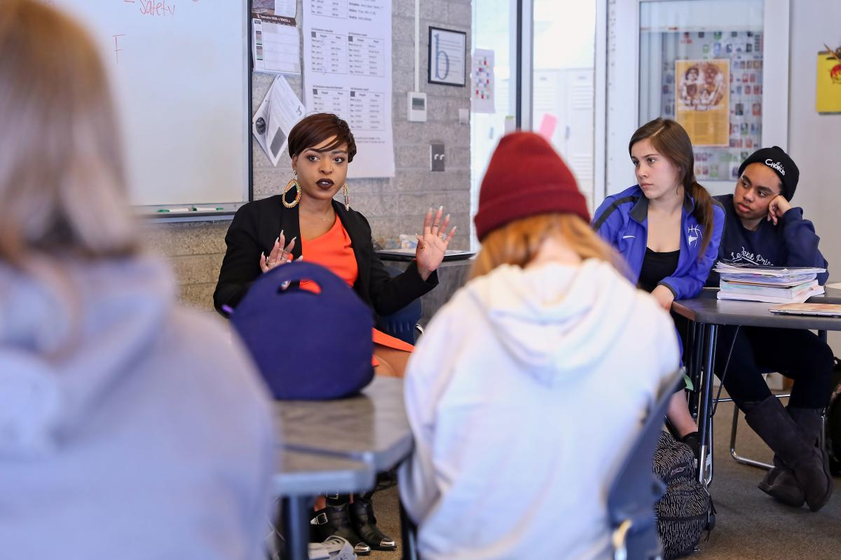 Booth leads a diversity workshop at the Bosque School, in Albuquerque.