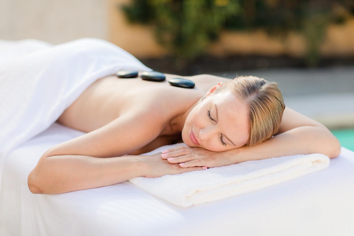 Woman enjoying hot stone massage at Miramonte Indian Wells Resort and Spa