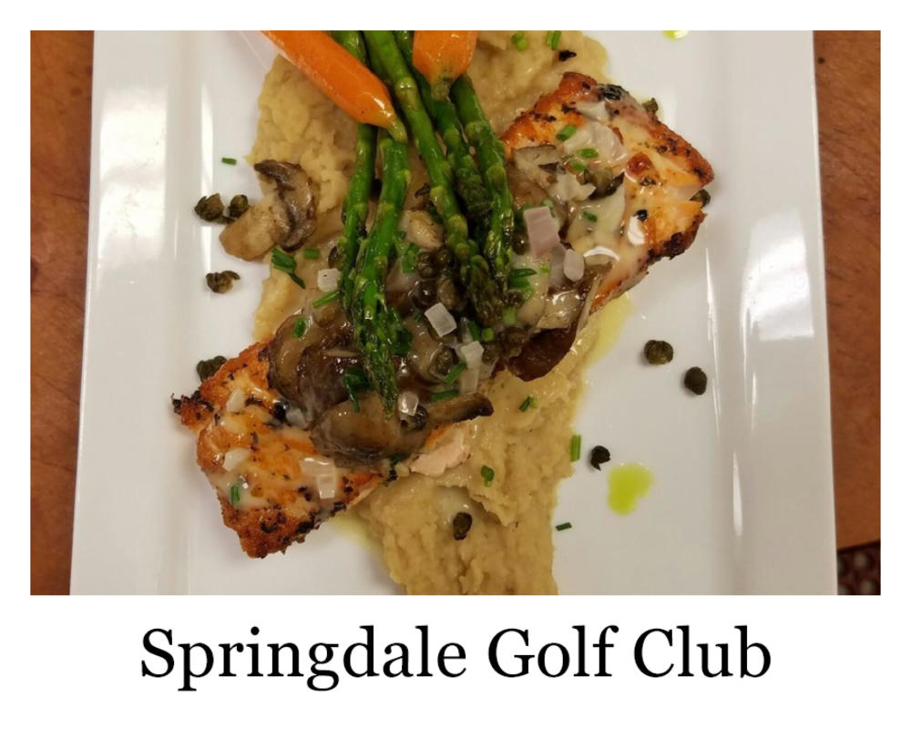 A plate of fish and veggies over mashed potatoes from Springdale Golf Club